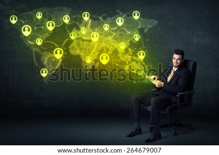 Businessman in office with tablet and social network world map concept on background - stock photo
