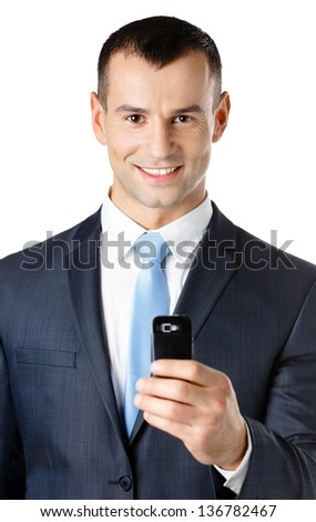 Businessman in suit and blue tie taking pictures with phone, isolated on white - stock photo