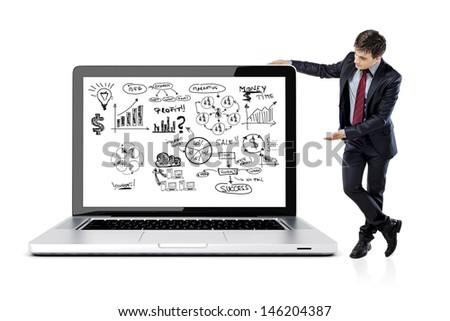 businessman in suit and business plan on laptop screen - stock photo