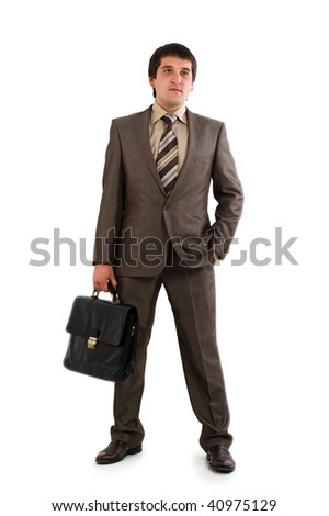 Businessman in suit holding briefcase. Isolated over white background - stock photo