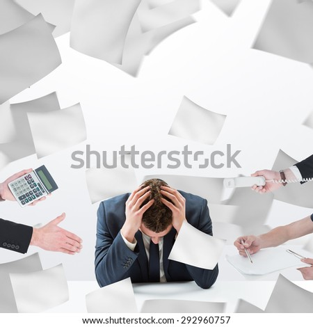 Businessman in suit offering his hand against sheets of paper flying - stock photo