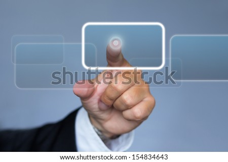 Businessman in suit pushing the interface button in virtual reality - stock photo