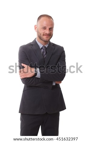 Businessman in suit standing arms crossed, smiling, looking at camera. - stock photo
