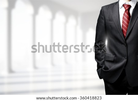 businessman in suit standing in room - stock photo