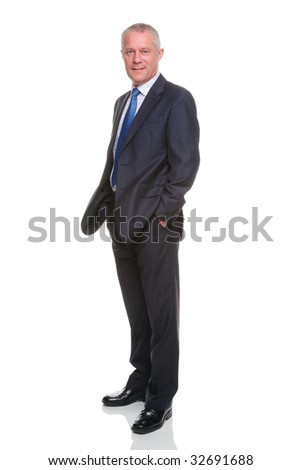 Businessman in suit with his hands in his pockets, isolated on a white background. - stock photo