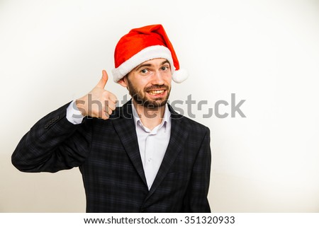 Businessman in suit with santa hat on head. Isolated over white background man beard business suit christmas cap - stock photo