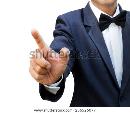 Businessman index finger pointing on imaginary space - stock photo