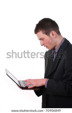 Businessman is considering something on the monitor of a laptop - stock photo