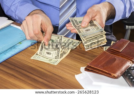Businessman is counting dollars banknotes, business and financial background - stock photo