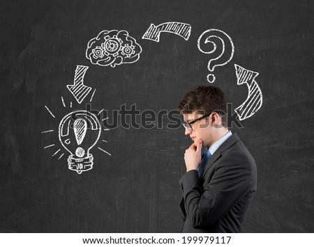 Businessman is developing a new strategy to start up a new business and trying to assess the risks. - stock photo