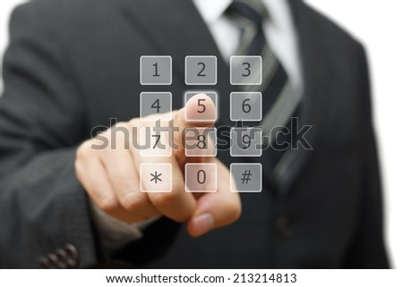 businessman is dialing on virtual telephone keypad - stock photo