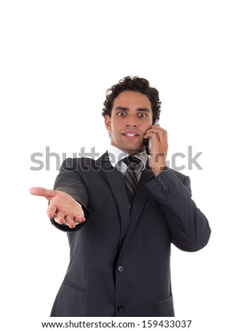 businessman is dissatisfied with the response he heard while talking on mobile - stock photo