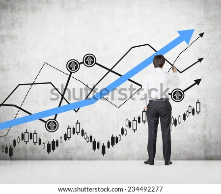 Businessman is Drawing a chart.  - stock photo
