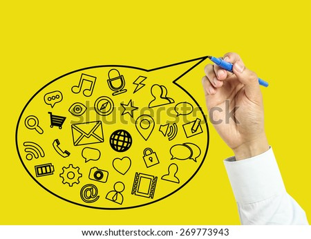 Businessman is drawing social media concept with marker on transparent board with yellow background. - stock photo