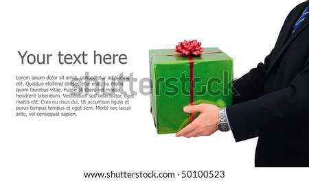 Businessman is giving a big present - stock photo