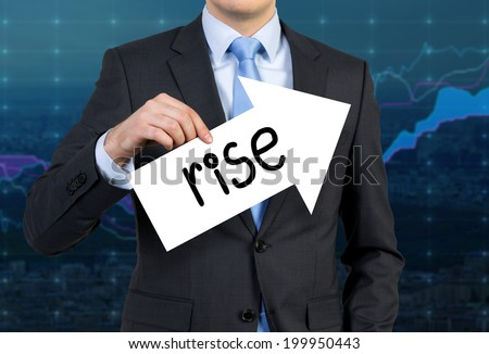 Businessman is holding an arrow sign with the word 'rise' which confirms the stable increase of forex market. - stock photo