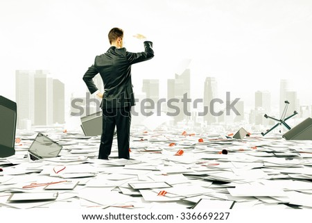 Businessman is looking at the horizont among pile of papers and office stuff - stock photo