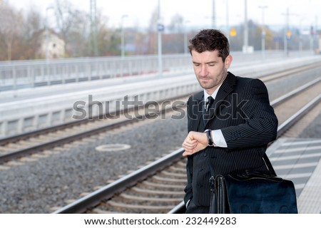 businessman is looking on his watch - stock photo