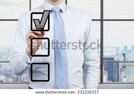 Businessman is making a choice. Office view. - stock photo