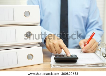 businessman is making report from company data - stock photo
