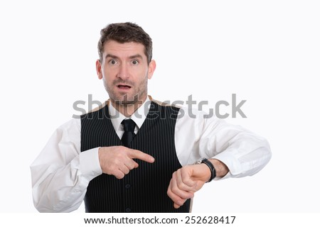 businessman is pointing on his watch - stock photo