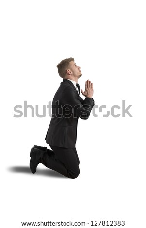 Businessman is praying to solve the financial crisis - stock photo