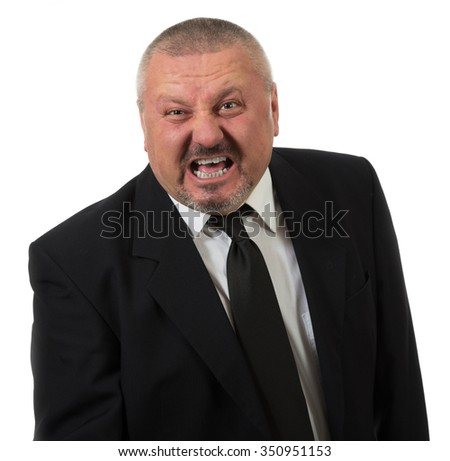 Businessman is red faced and very angry - stock photo