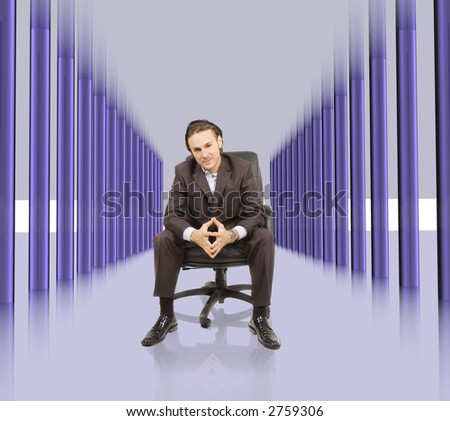 businessman is sitting in high tech hallway - stock photo