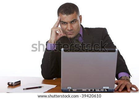 Businessman is sitting on his desk and thinks about a problem. - stock photo