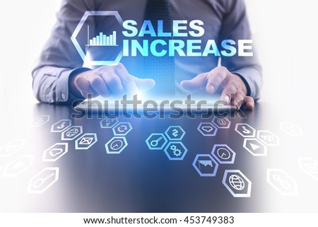 Businessman is using tablet pc and selecting Sales Increase icon. - stock photo