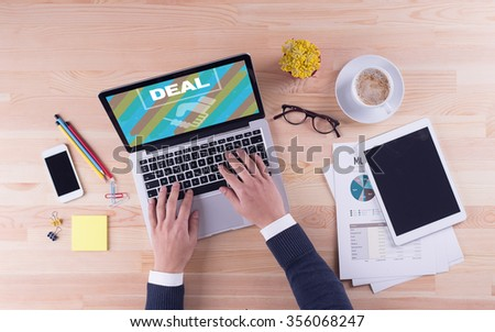 Businessman is working on desk - DEAL - stock photo