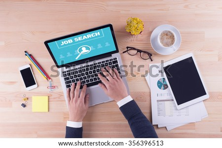Businessman is working on desk - JOB SEARCH - stock photo