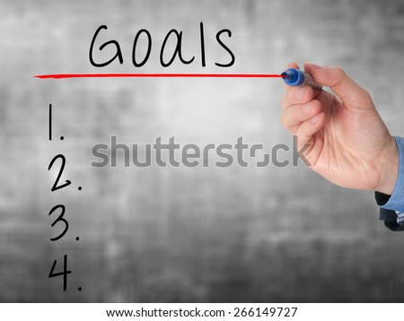 Businessman is writing goals list,  planning on whiteboard. Isolated on grey. Stock Image - stock photo
