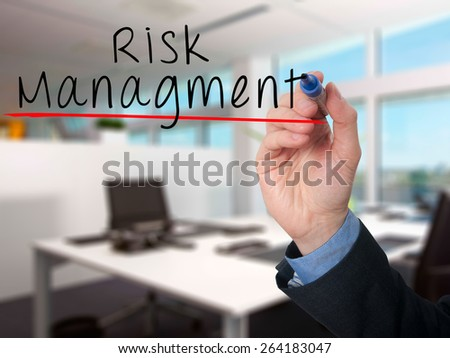 Businessman is writing Risk Management on the transparent board. Isolated on office background. Stock Image - stock photo