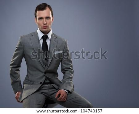 Businessman isolated on grey background - stock photo