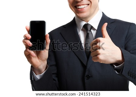 businessman isolated on white with mobile phone shows thumb up - stock photo