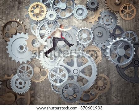 businessman jump over 3d metal gear - stock photo