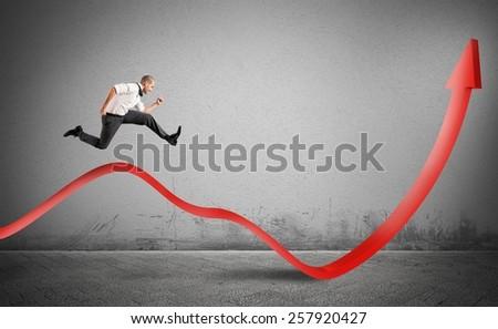 Businessman jump up toward the economic growth - stock photo