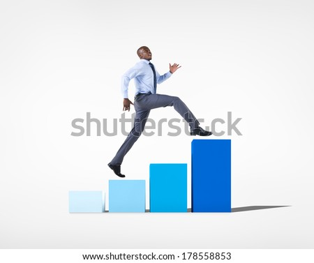 Businessman Jumping on a Developing Graph - stock photo
