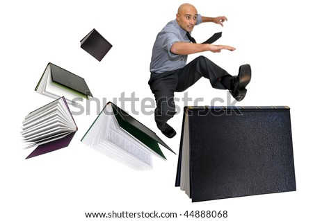 Businessman jumping over books isolated in white - stock photo