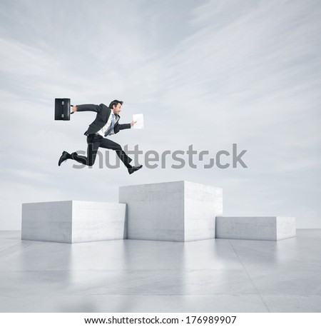 Businessman jumping to highest cube - stock photo