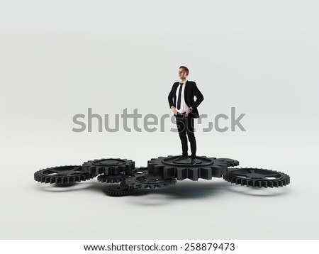 Businessman leader with cog wheel elements. Construction concept - stock photo