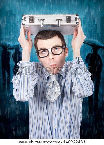 Businessman leading a team through a legal battle crisis of falling rain with secure documents. Insurance cover - stock photo