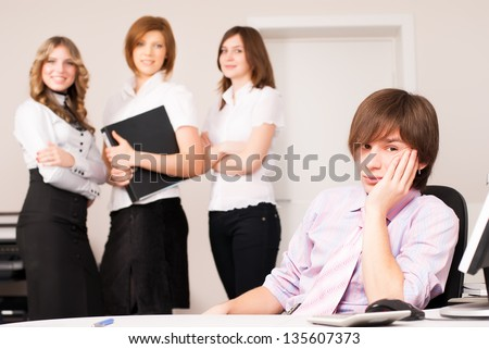 Businessman leading team of business ladies in office - stock photo