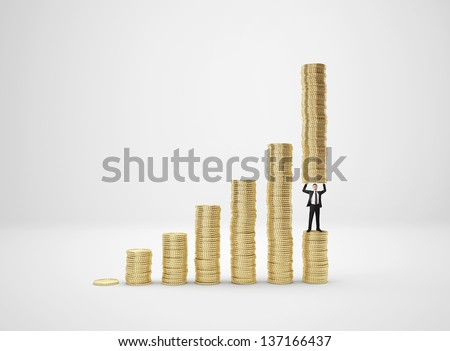 Businessman lifting coins - stock photo