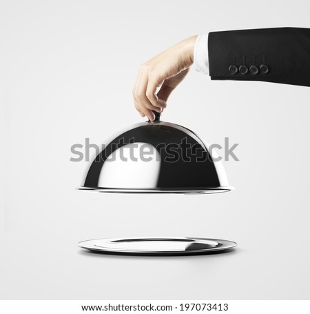 Businessman lifting the lid of the tray  - stock photo