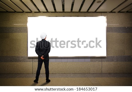 Businessman look at the board - stock photo