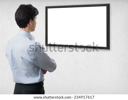 businessman looking at blank computer screen with copy space - stock photo