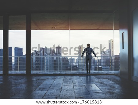 Businessman looking at city - stock photo