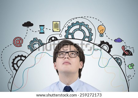 businessman looking at drawing business icons over head - stock photo
